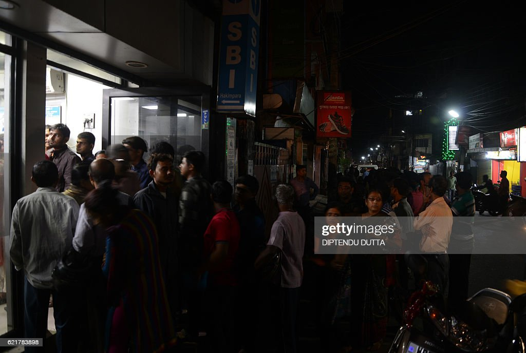 Indian residents queue to try to withdraw money from an ATM in Siliguri on November 8 2016 Indian Prime Minister Narendra Modi announced late...