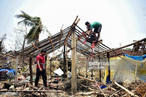 Indian residents rebuild houses after they got destroyed by the cyclone 'Fani' in Puri in the eastern Indian state of Odisha on May 12 2019 Millions...