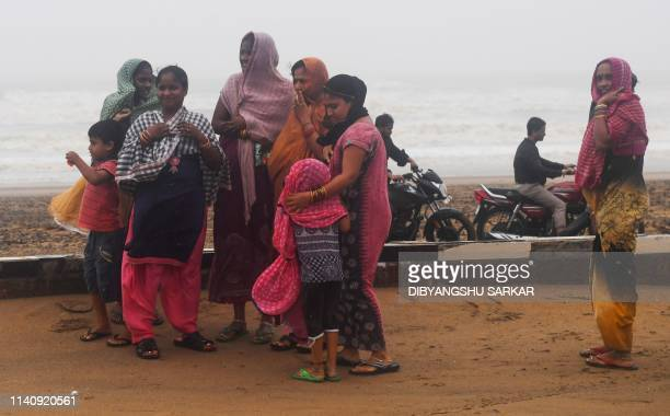 Indian residents stand a beachfront after Cyclone Fani landfall in Puri in the eastern Indian state of Odisha on May 3 2019 Two people died on May 3...
