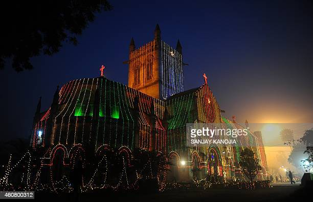 Indian residents walk in front of All Saints Cathedral in Allahabad on December 23 decorated ahead of Christmas celebrations Despite Christians...