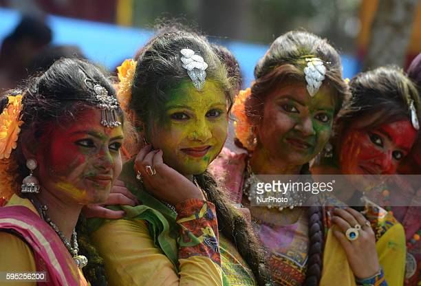 Indian revelers dance during celebrations marking Holi the Hindu festival of colors in SiliguriWest Bengal India Wednesday March 23 2016 The holiday...