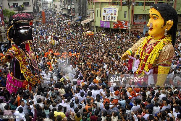 Indian revellers gather around idols as they are paraded to celebrate The Marbat Festival in Nagpur on September 2 2016 The festival which is unique...