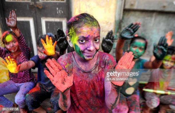 TOPSHOT Indian revellers play with colours during Holi celebrations in Chennai on March 13 2017 The Hindu festival of Holi or the 'Festival of...