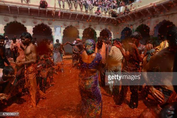 Indian revellers take part in the game of 'Huranga' at The Dauji Temple in Mathura some 100kms south of New Delhi on March 18 2014 'Huranga' is a...