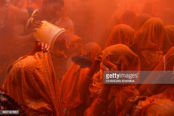 TOPSHOT Indian revellers take part in the game of 'Huranga' at The Dauji Temple in Mathura some 100 kms south of New Delhi on March 14 2017 'Huranga'...
