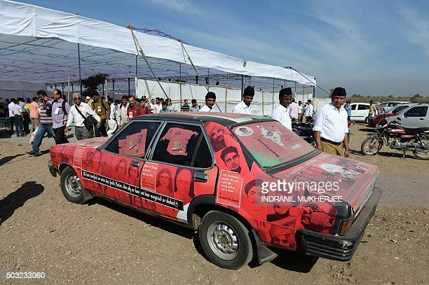 Indian right wing Rashtriya Swayamsevak Sangh volunteers inspect a car plastered with posters of freedom fighters at a rally in Pune some 135 kms...