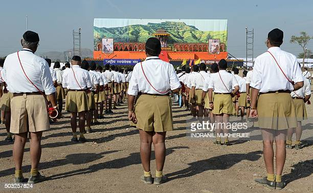 Indian right wing Rashtriya Swayamsevak Sangh volunteers stand in formation as they listen to instructions at a rally in Pune some 135 kms from...