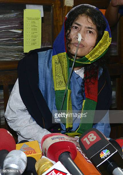 Indian rights activist Irom Sharmila talks to media after appearing before a District and Sessions Judge at Imphal West court in Imphal on August 9...