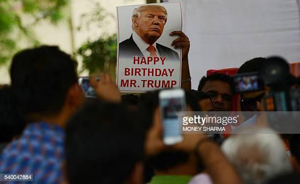 Indian rightwing Hindu activists hold a celebration to mark the 70th birthday of US Republican presidential candidate Donald Trump in New Delhi on...