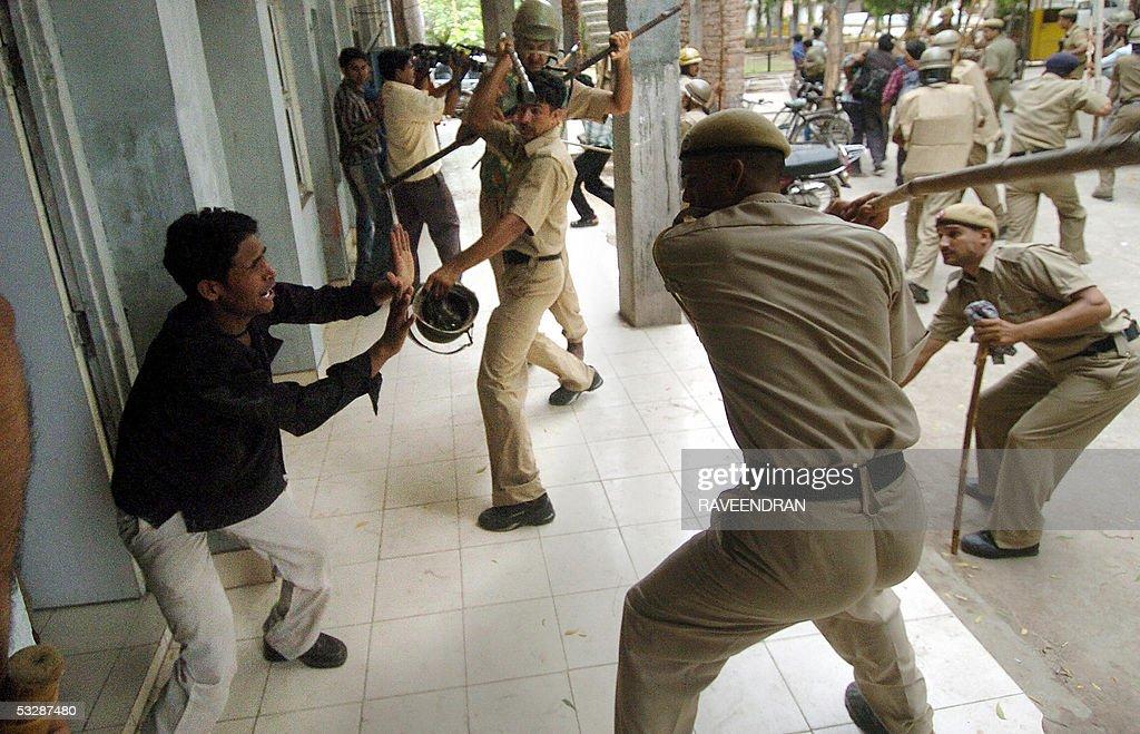 Indian riot policemen beat a demonstrato : News Photo