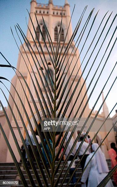 Indian Roman Catholic Christians enter the St Mary's Church for a mass in Secunderabad the twin city of Hyderabad on March 16 on the occasion of Palm...