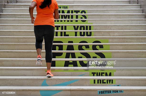 Indian runners take part in a staircase run organised by a multinational sports brand as part of training for the forthcoming TCS World 10K run in...