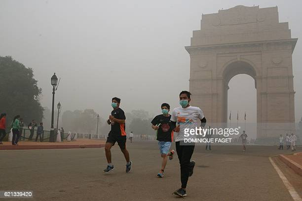 Indian runners take part in the New Delhi 10K Challenge amid heavy smog in New Delhi on November 6 2016 Thick smog has blanketed the capital for days...
