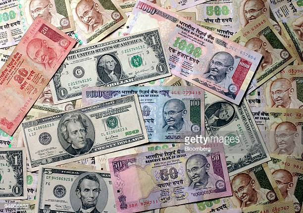 Indian rupee notes and US dollar bills are photographed in New Delhi India Sunday September 3 2006 India's central bank will consult the government...