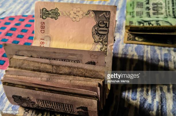 indian rupees notes bundle - indian currency stock photos and pictures