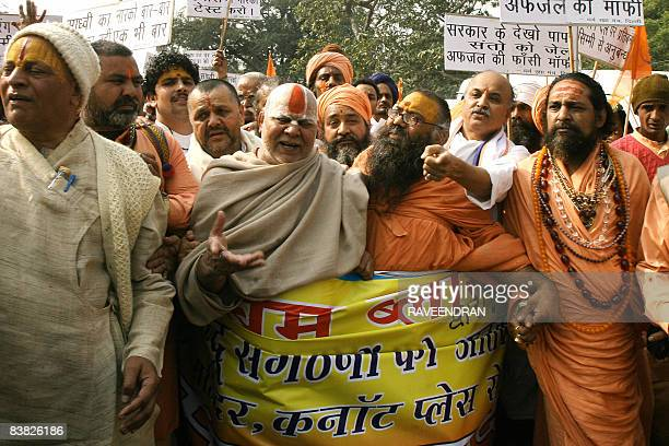 Indian sadhus holy men shout antigovernment slogans during a protest march in New Delhi on November 26 2008 against the arrest of holy woman Sadhvi...