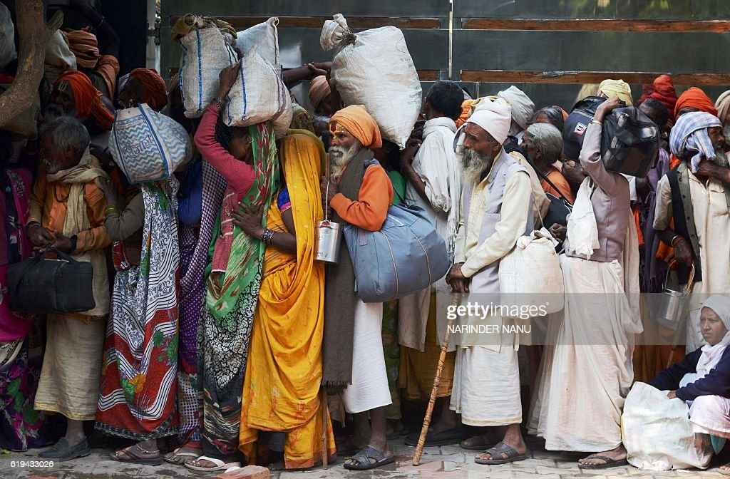 TOPSHOT Indian Sadhus queue to receive blankets during a Sadhu congregation following the Diwali Festival in Amritsar on October 312016 Thousands of..