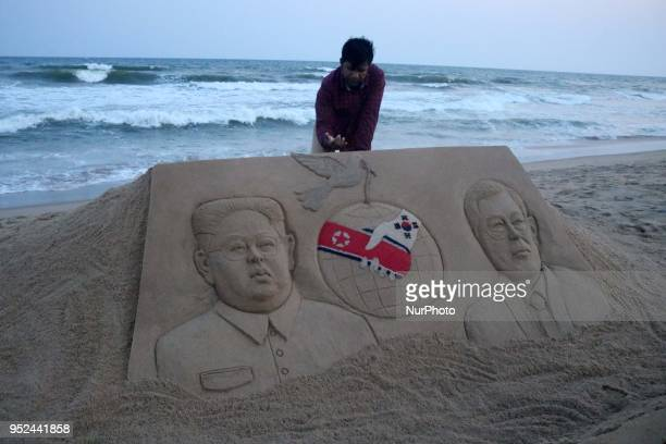 Indian Sand artist Sudarsan Pattnaik created a sand sculpture on the historic meeting of both the president of North Korea and South Korea with...