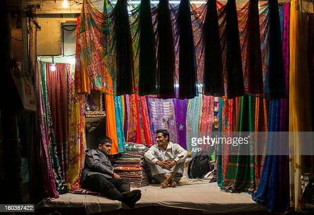 Indian sari vendors share a light moment in the Old Quarters in New Delhi on January 30 2013 Emerging economies are set to grow faster than the...