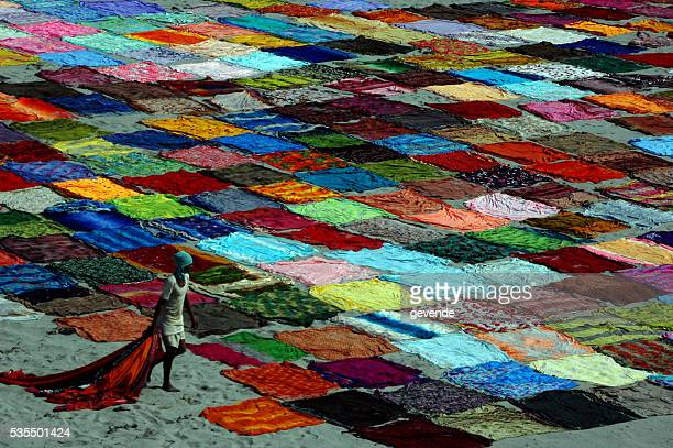 Indian saris drying along the river bank in Agra.