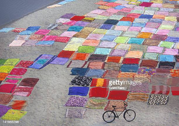 indian saris drying in the sun - patchwork stock pictures, royalty-free photos & images