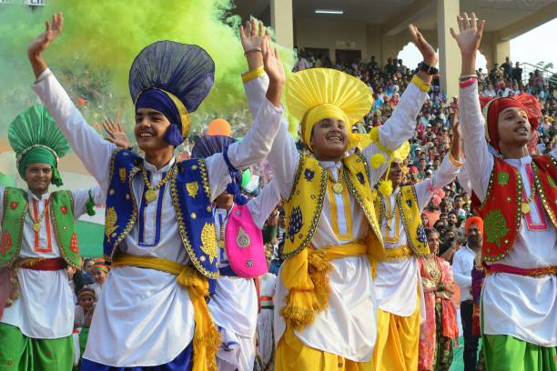 Indian school boys perform the Punjabi dance known as Bhangra during India`s 72nd Independence Day celebrations at the India Pakistan Wagah Border...