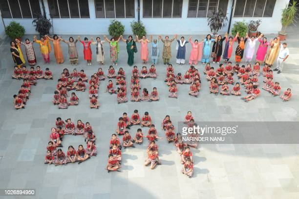 Indian school children along with teachers gesture during celebrations for 'Teacher's Day' at a school in Amritsar on September 5 2018 September 5 is...