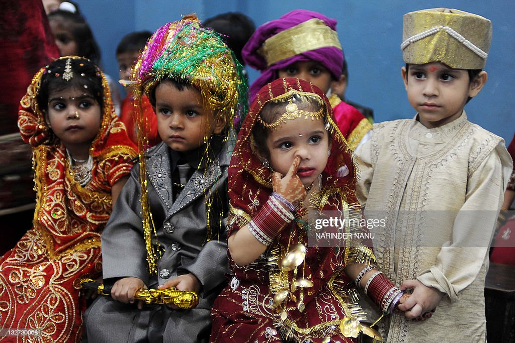 Indian school children dressed as bride and grooms wait to perform during celebrations of Children`s Day at a school in Amritsar India`s northwestern.