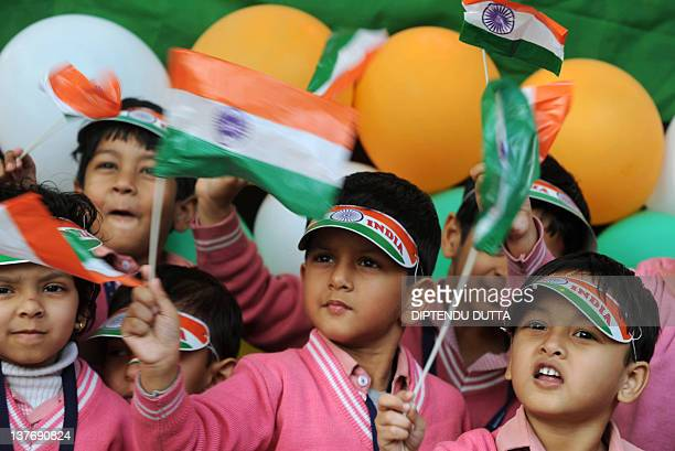Indian school children of prepartory school Bright Academy wave Indian national flags in Siliguri on January 25 2012 on the eve of India's Republic...