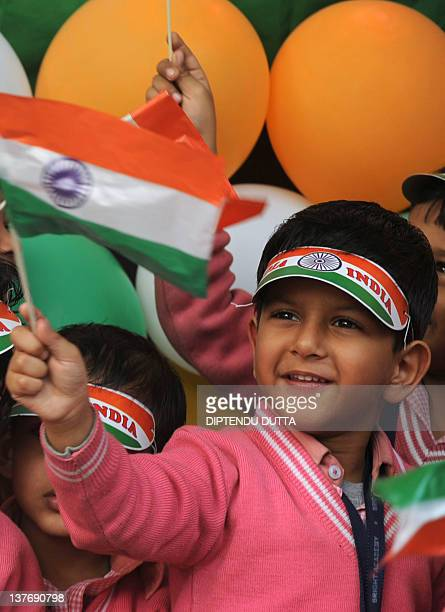 Indian school children of prepartory school Bright Academy waves Indian national flags in Siliguri on January 25 2012 on the eve of India's Republic...