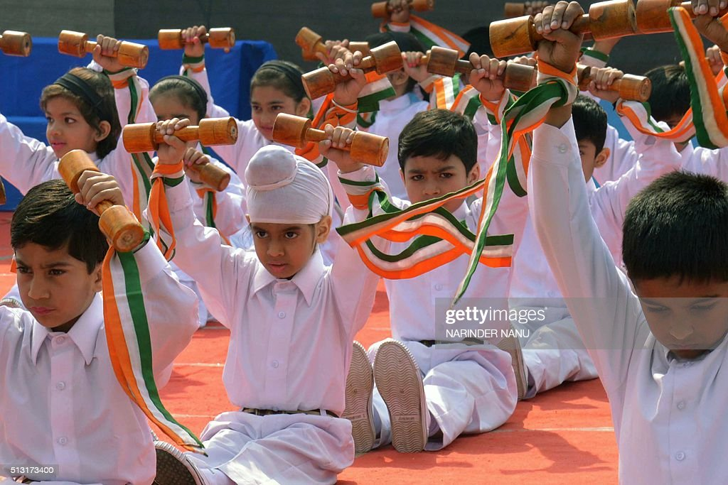 Indian school children perform morning exercises at a school in Amritsar on March 1 2016 AFP PHOTO / NARINDER NANU / AFP / NARINDER NANU