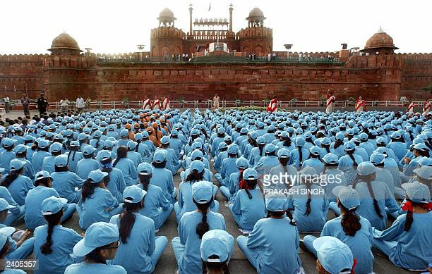 Indian school children sit in front of the Red Fort as they take part in a fulldress rehearsal of the Independence day celebrations in New Delhi 13...