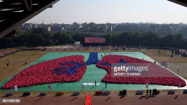 TOPSHOT Indian school children take part in a successful attempt to create the Guinness World Record for the largest amount of people making an image...