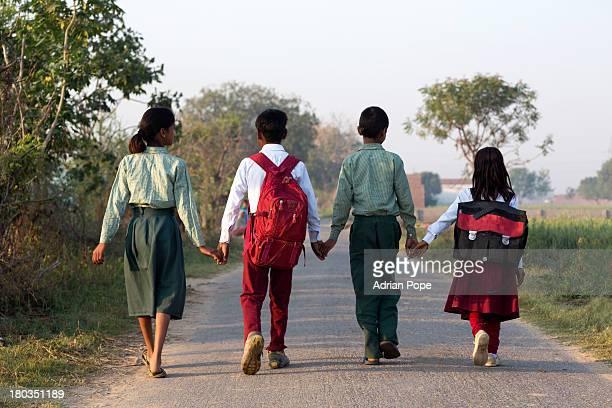 Indian school children walking to school