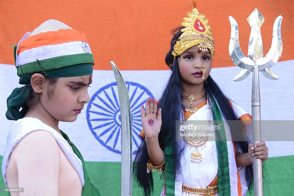 Indian school girl dressed as goddess Bharat Mata performs during a function at a school in Amritsar on November 26 2013 AFP PHOTO/NARINDER NANU