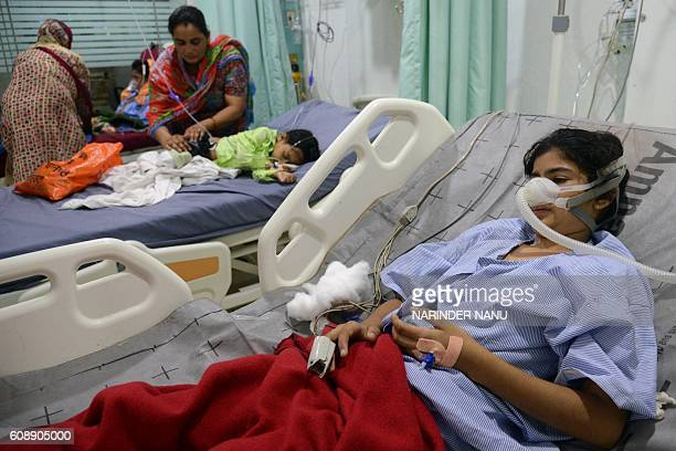 Indian school girl Palak injured in a bus accident rests at a hospital in Amritsar on September 20 2016 Eight schoolchildren were killed and 15...