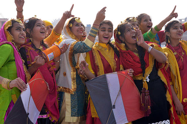 Indian school girls fly kites during celebrations on the eve of the Lohri festival in Amritsar on January 12 2016 The Lohri harvest festival which...