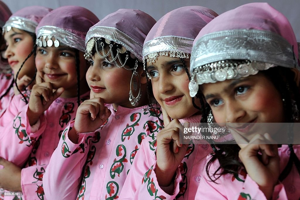 Indian school girls in traditional Kashmiri dress await their turn to perform at a school function in Amritsar on December 16 2009 AFP PHOTO/NARINDER.