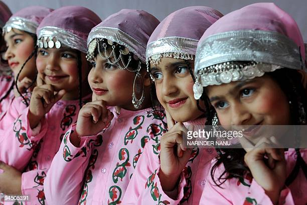 Indian school girls in traditional Kashmiri dress await their turn to perform at a school function in Amritsar on December 16 2009 AFP PHOTO/NARINDER...