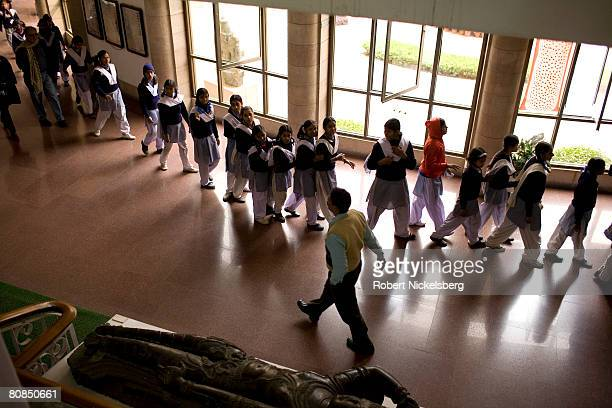 Indian school girls line up to view exhibits at the National Museum in New Delhi India February 2 2008 With the nation's rapid economic growth Indian...