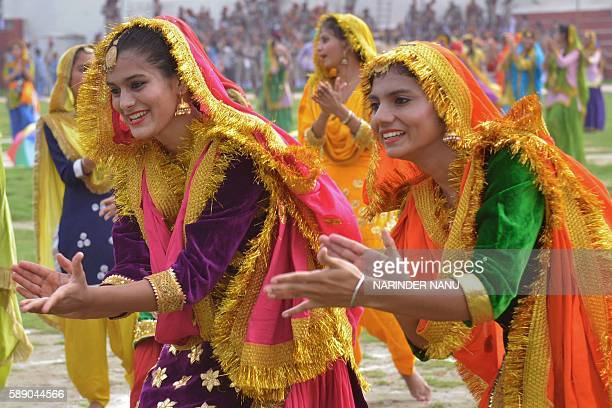 Indian school girls wear traditional Punjabi dress as they perform the Punjabi dance the 'giddha' during the final dress rehearsal for Independence...
