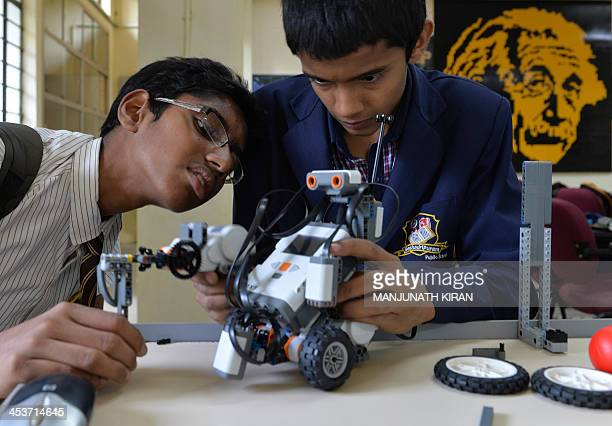 Indian school students assemble a robot before programming it to perform tasks at the Sir M Visvesvaraya Industrial and Technological Museum as part...