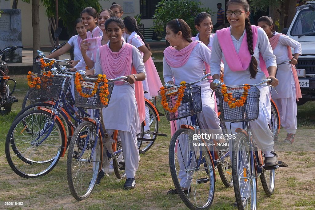 Indian school students cycle on bicycles donated by Punjab Transport Minister Ajit Singh Kohar at a government school in Amritsar on August 4 2016...