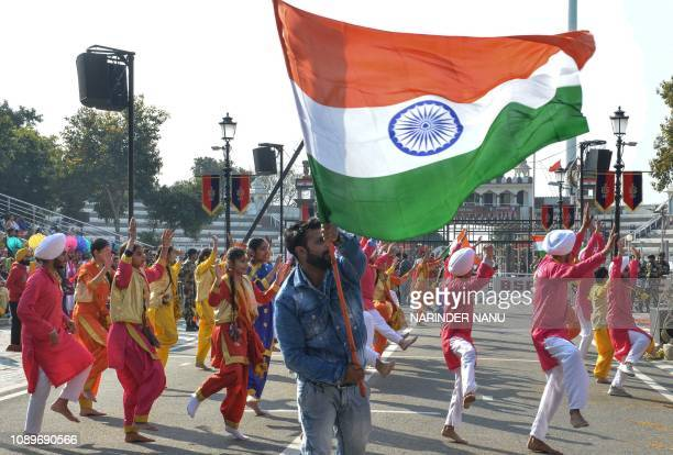 Indian school students dance during Republic Day celebrations at the IndiaPakistan Wagah border post about 35 kilometers from Amritsar northeastern...