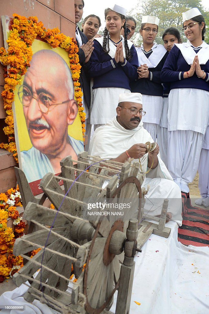 Indian school students pay their respects on the occasion of Martyr's Day in Amritsar on January 30, 2013, the 65th anniversary of Gandhi's assassination. Mahatma Gandhi was on the way to a prayer meeting in the Indian capital New Delhi when he was shot three times in the chest and head on January 30, 1948.
