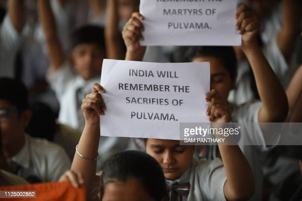 Indian school students pay tribute to the Central Reserve Police Force personnel killed on February 14 during an attack on a CRPF convoy in the...