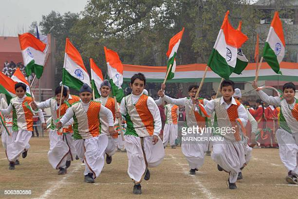 TOPSHOT Indian school students perform during a rehearsal for the upcoming 67th Republic Day parade in Amritsar on January 23 2016 India will...