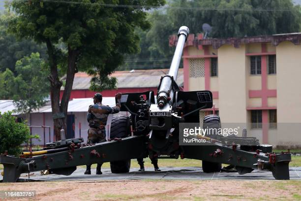Indian school students take a close look at the various defence equipment during an exhibition organised by the Indian Army in Ajmer Rajasthan India...