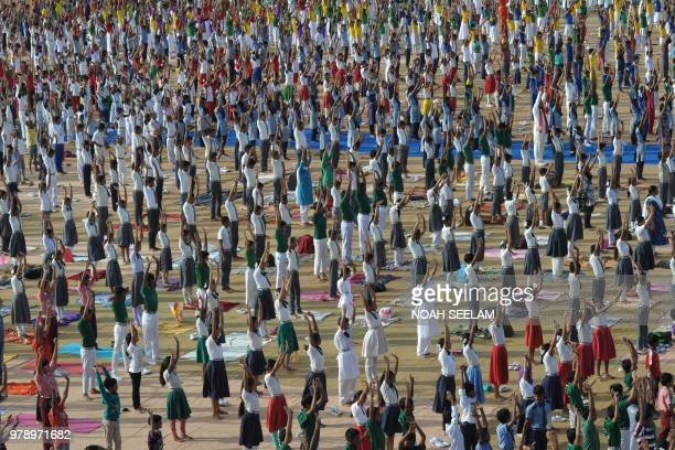 TOPSHOT Indian school students take part in a yoga camp in Hyderabad on June 20 ahead of International Yoga Day celebrated every year on June 21 Yoga...