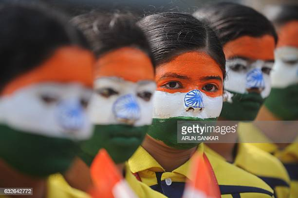 TOPSHOT Indian school students wearing facepaint depicting the national flag take part in an event to mark Republic Day in Chennai on January 25 2017...